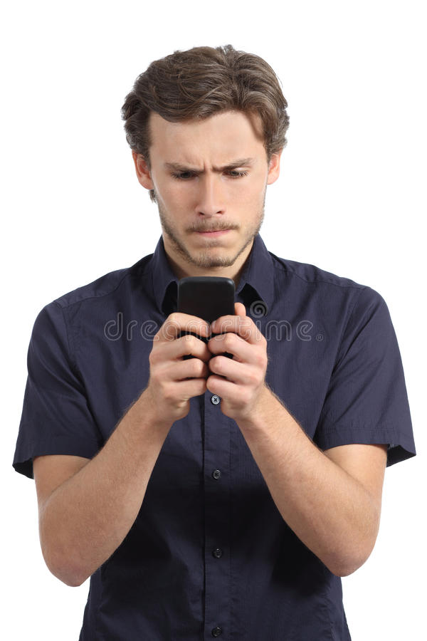 Young man obsessed with his smart phone royalty free stock photography