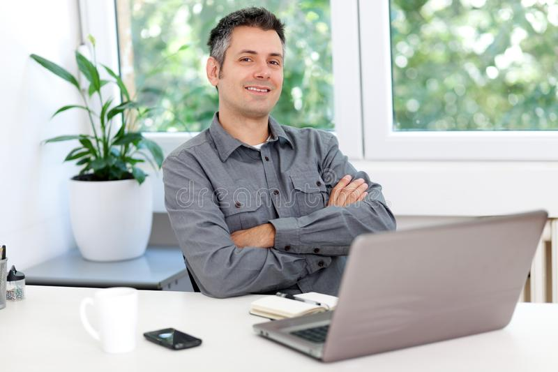 Young man at the office stock images