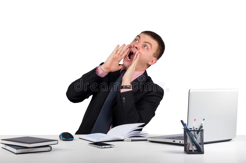 Young man in office shouting with hands cupped to his mouth isolated on white background royalty free stock photos
