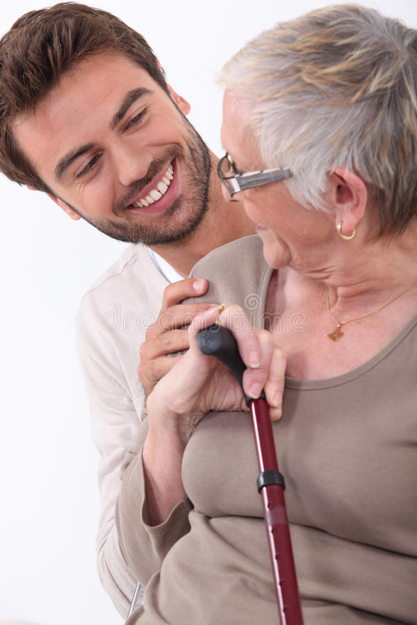 Download Young man and older woman stock image. Image of 25, care - 26500937