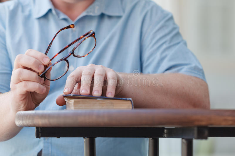 Young man opening and reading a book, close up. stock photos