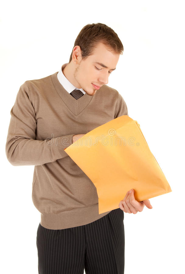 Young man opens a post package royalty free stock images