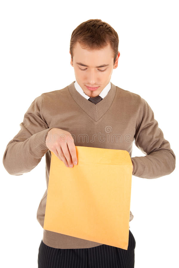 Young man opens a post package stock photo