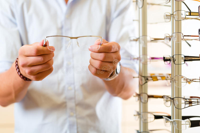 Young man at optician with glasses