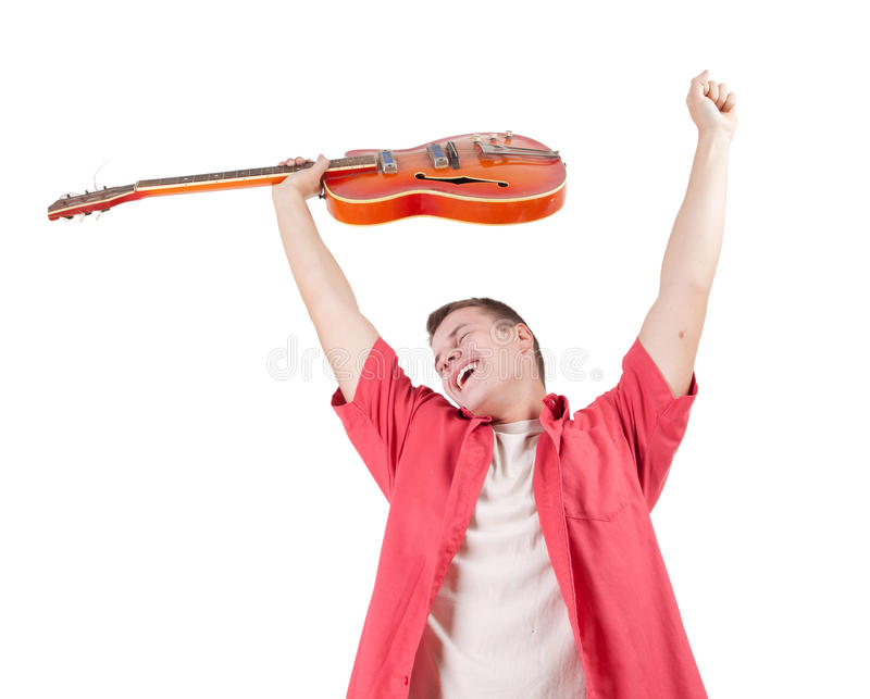 Young man with orange electric guitar stock photo