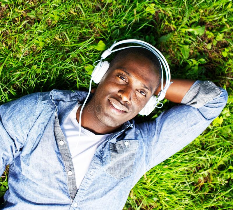 Download Young man outdoors stock image. Image of headphones, african - 33821153