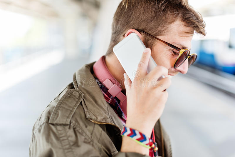 Young Man Outdoors Talking Smartphone Concept royalty free stock image