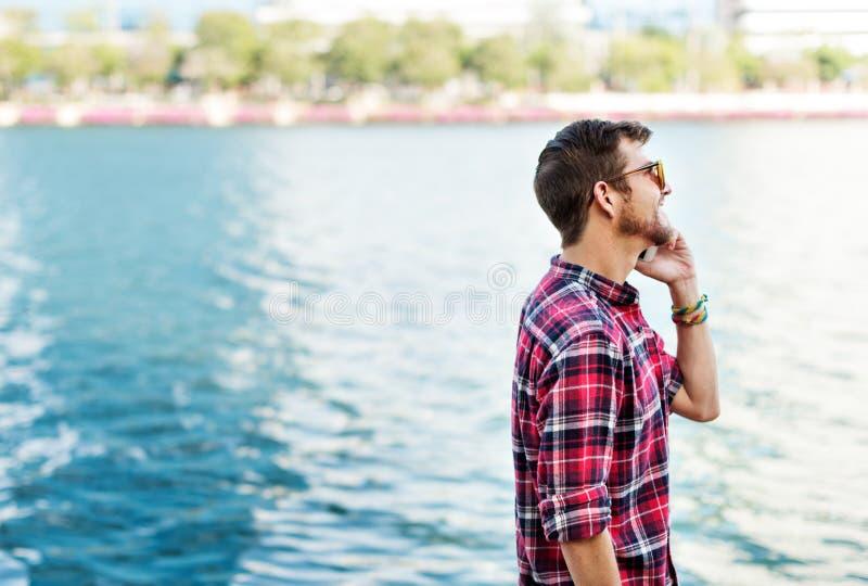 Young Man Outdoors Talking Smartphone Concept stock photos