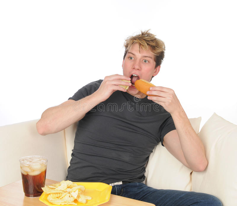 Download Young man overeating stock photo. Image of casual, copyspace - 25268232