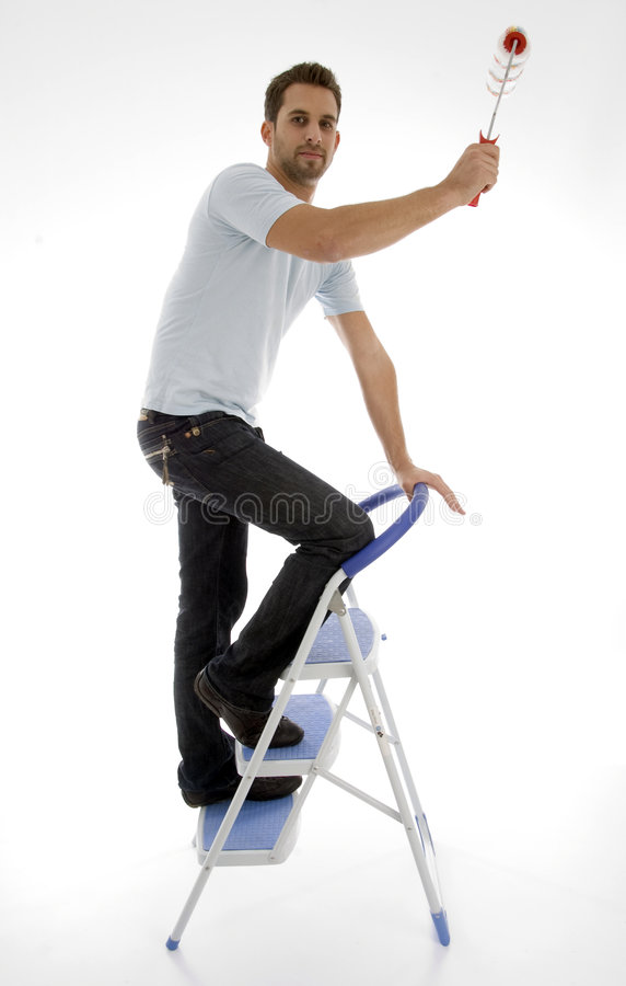 Young man painting stock images