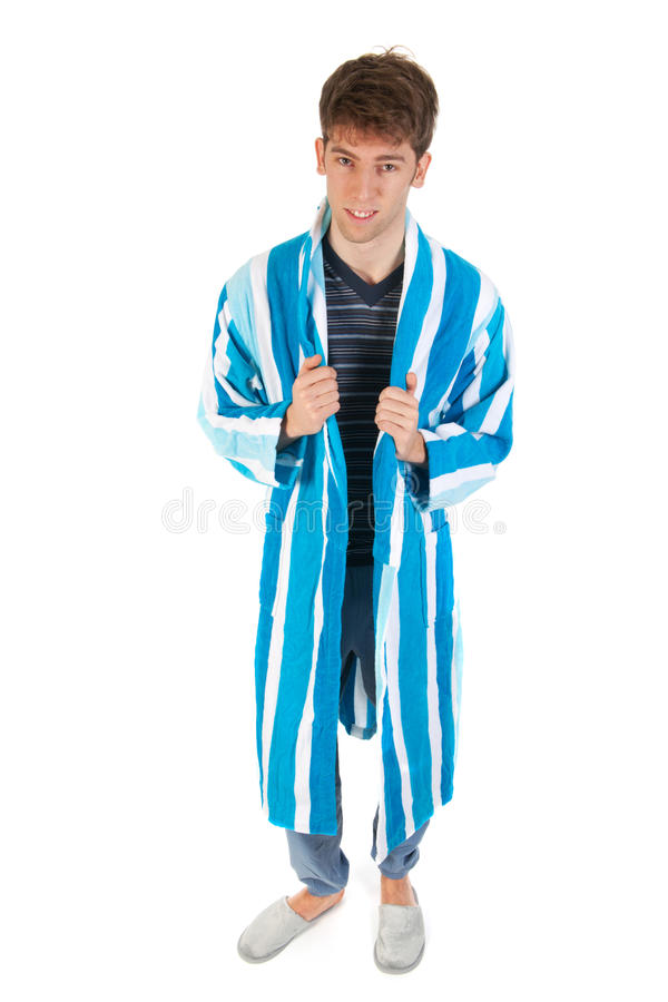 Young man in pajamas and gown