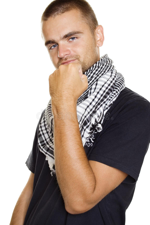 Young man in a Palestinian scarf. Young man dressed in black t-shirt at the neck of a Palestinian scarf. Stubble on his face. Shows a fist in the frame. Isolated royalty free stock photos