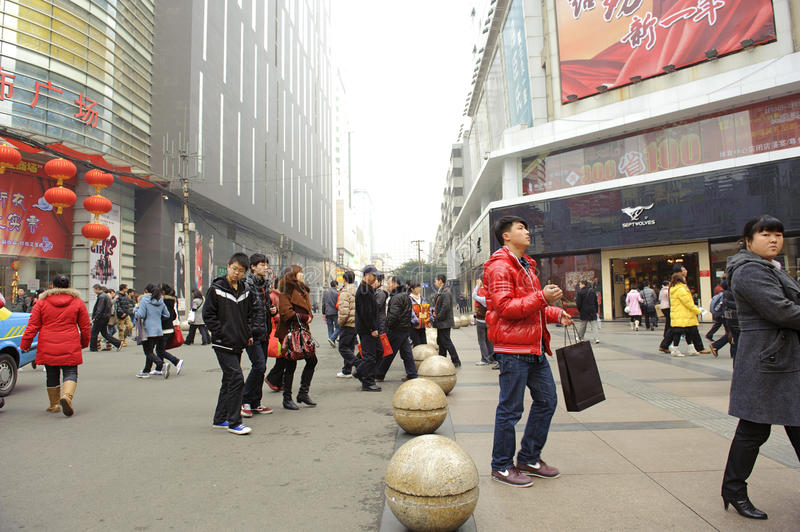 Download A Young Man Pass Through A Busy Street Editorial Image - Image: 18387915