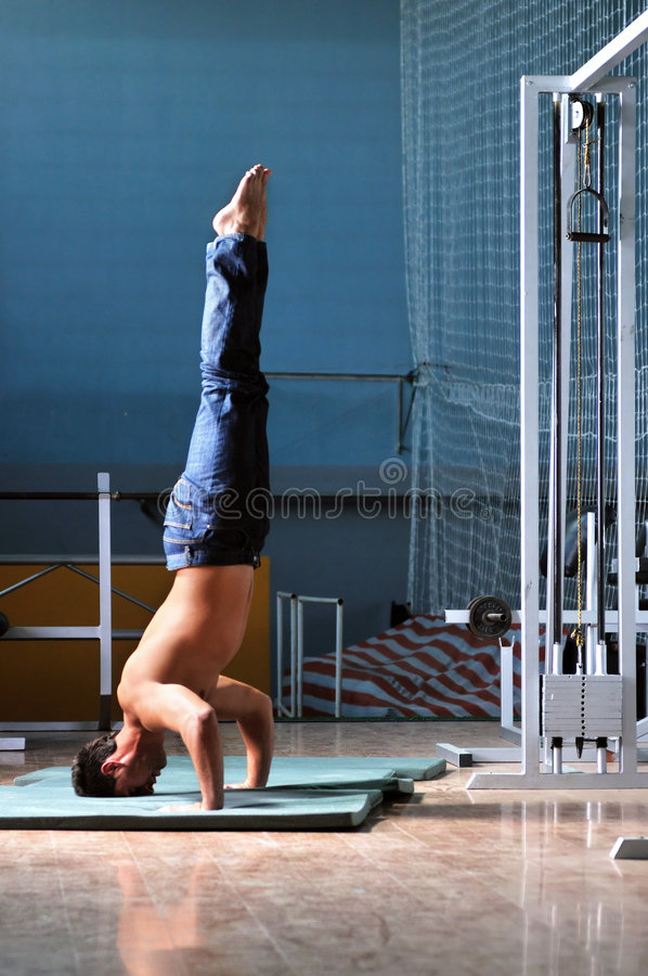 Download Young Man Performing  Handstand In Fitness Studio Stock Image - Image: 8065261