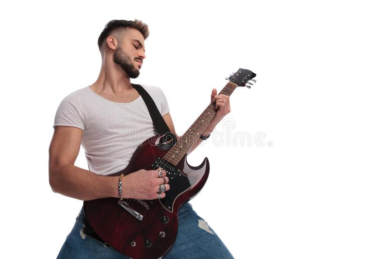 Young man performing a rock and roll concert on guitar stock photo