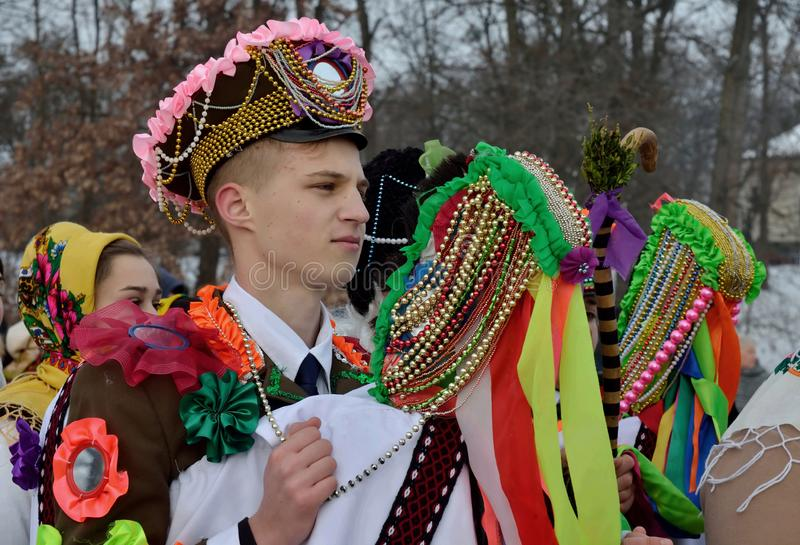 Young man performs Christmas and Malanka songs during ethnic festival in open-air museum,Ukraine stock images