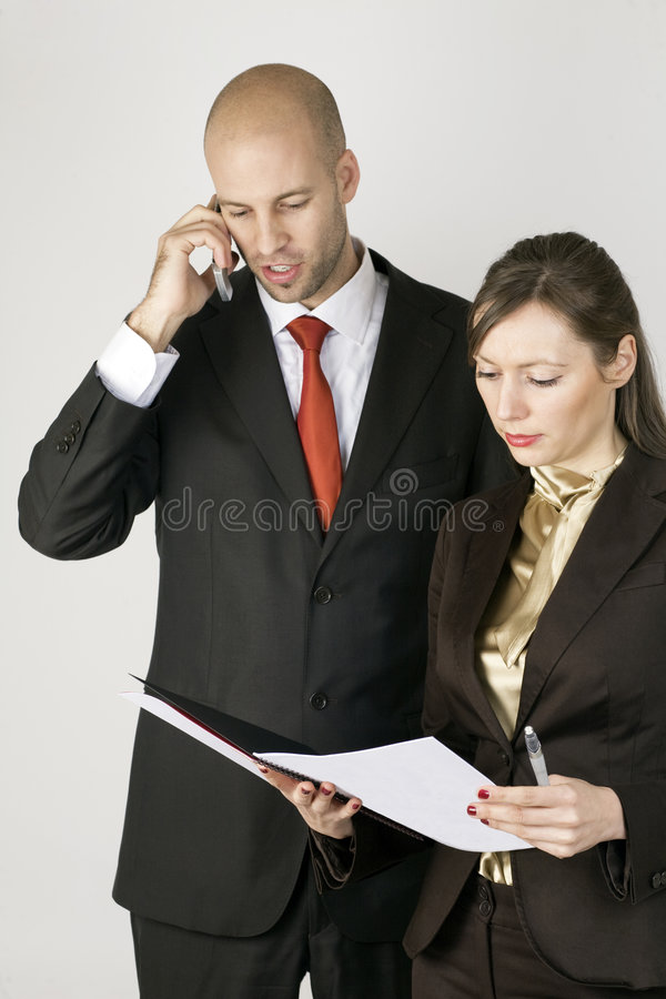 Young man on phone with assistent royalty free stock photo