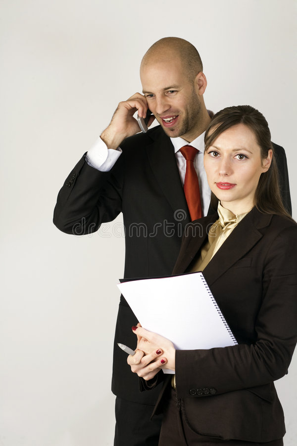 Download Young Man On Phone With Assistent Stock Photo - Image: 8951518