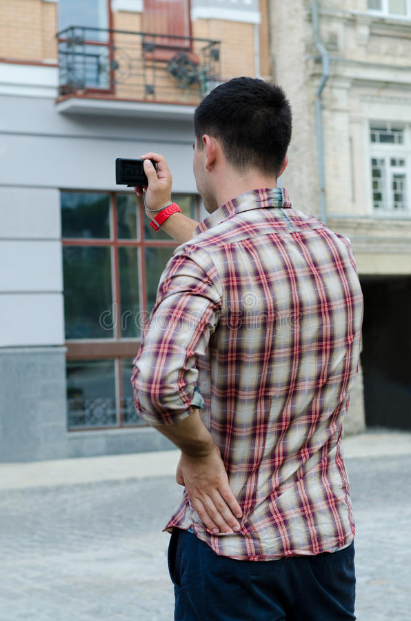 Download Young Man Photographing A Building Stock Image - Image: 25977089