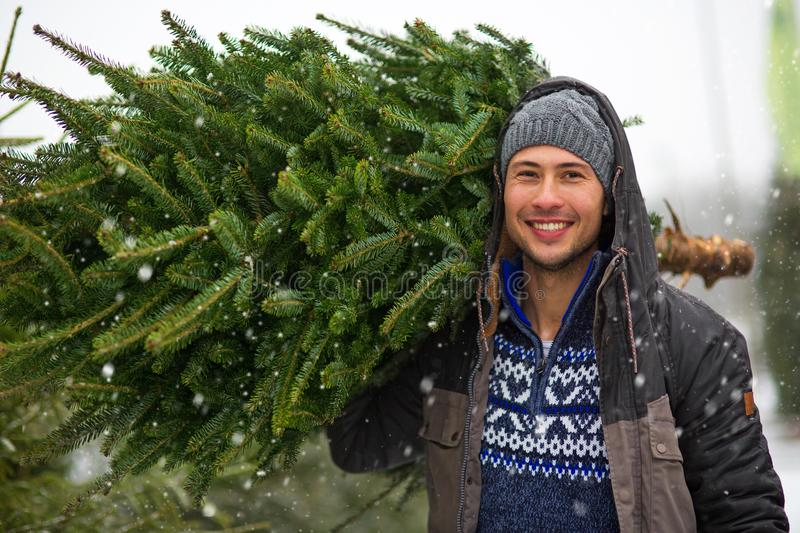 Young Man Buying Christmas Tree stock images