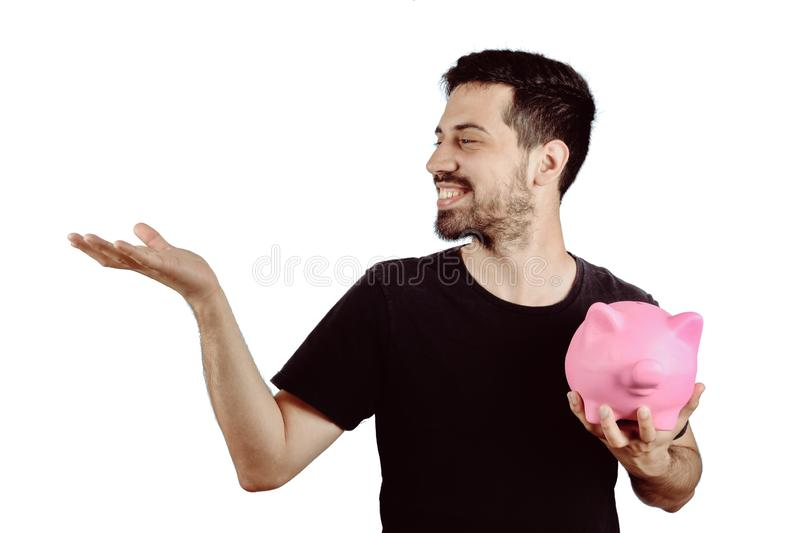 Young man with piggy bank. Portrait of young man with piggy bank on studio. Save money concept royalty free stock photos