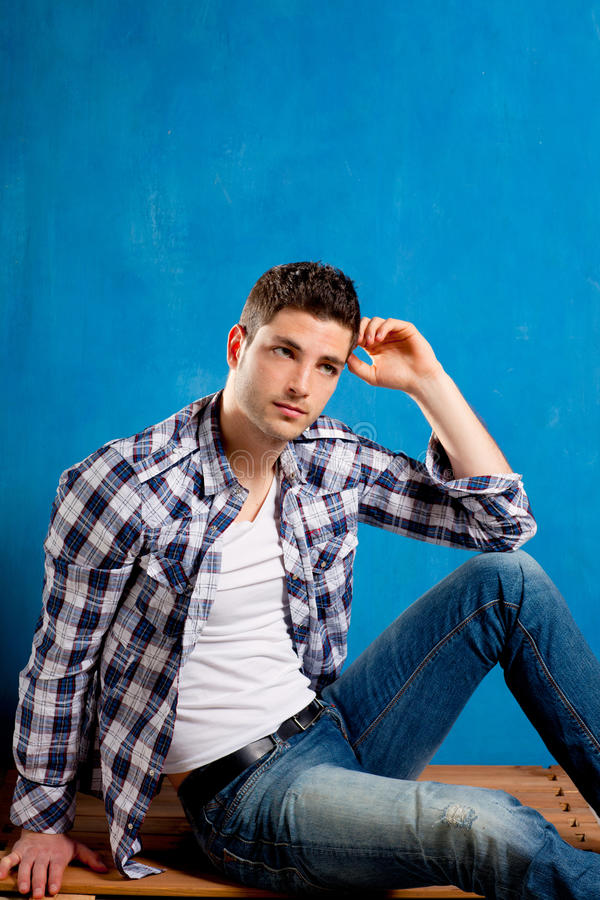 Download Young Man With Plaid Shirt Denim Jeans In Blue Stock Image - Image: 24164281
