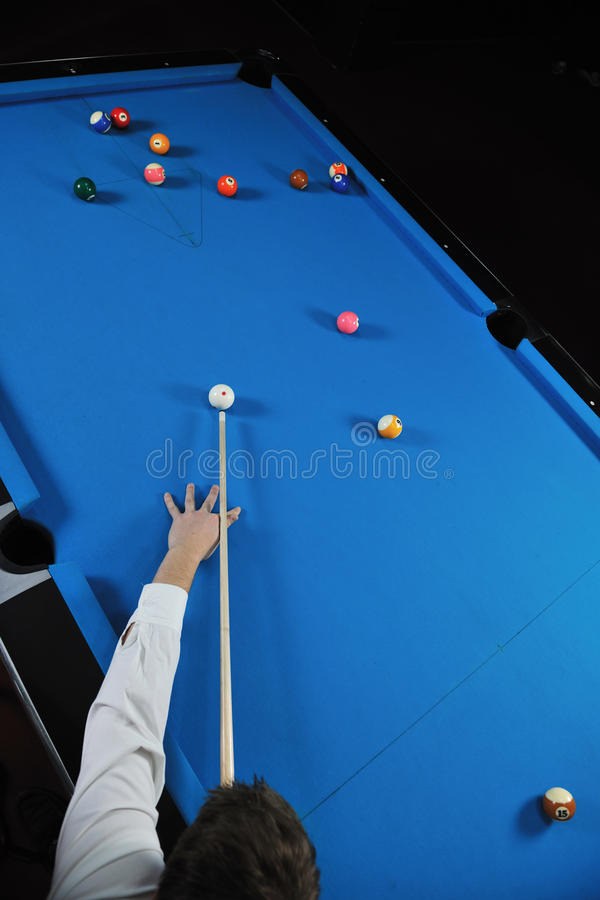 Young man play pro billiard game. Young pro billiard player finding best solution and right angle at billard or snooker pool sport game royalty free stock photos