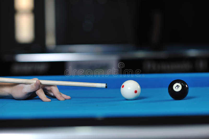 Young man play pro billiard game. Young pro billiard player finding best solution and right angle at billard or snooker pool sport game royalty free stock images
