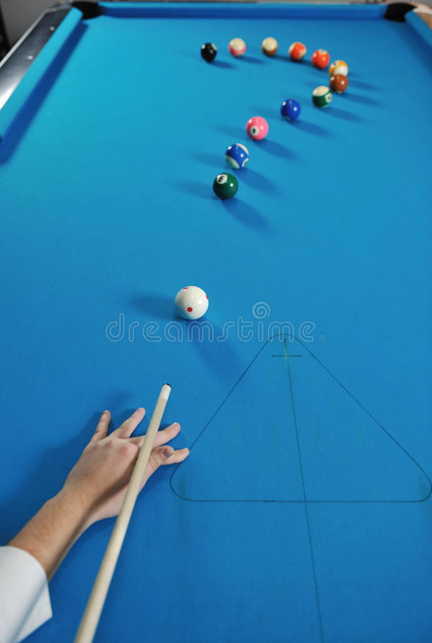 Young man play pro billiard game. Young pro billiard player finding best solution and right angle at billard or snooker pool sport game stock images