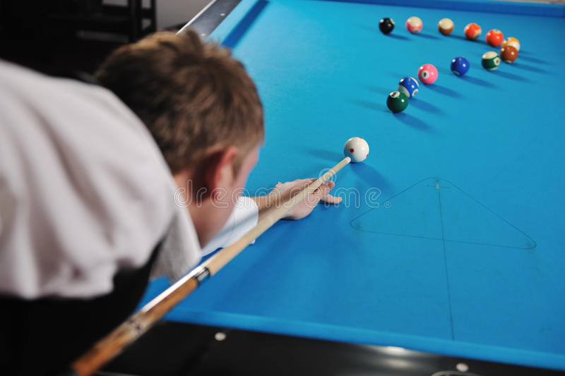 Young man play pro billiard game. Young pro billiard player finding best solution and right angle at billard or snooker pool sport game stock photos