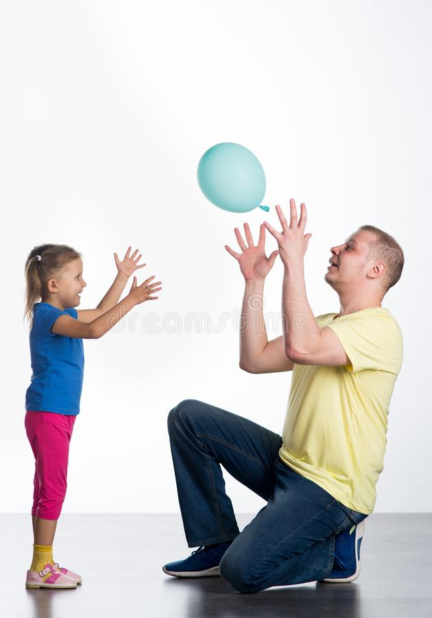 Young man playing with baby royalty free stock images