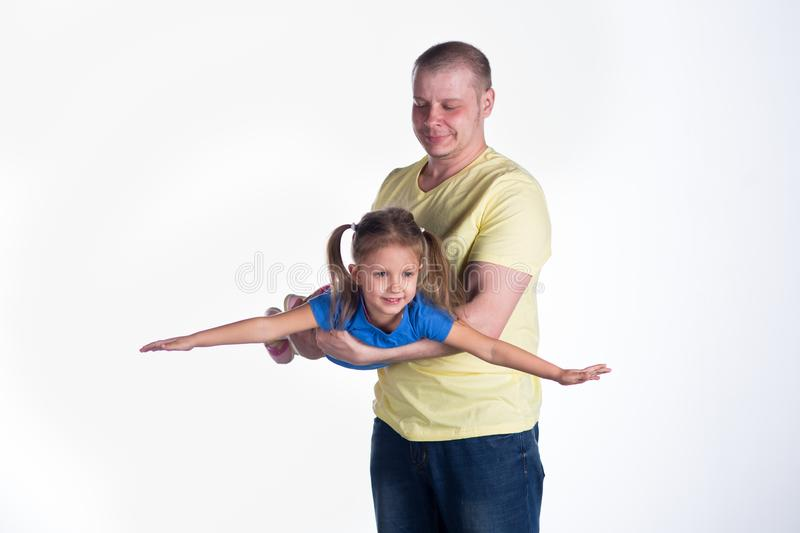Young man playing with baby stock photos