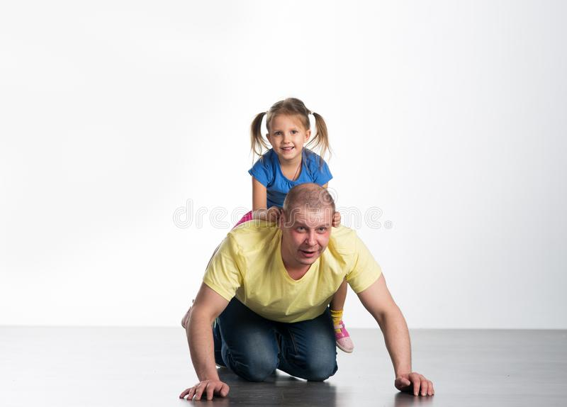 Young man playing with baby royalty free stock photos