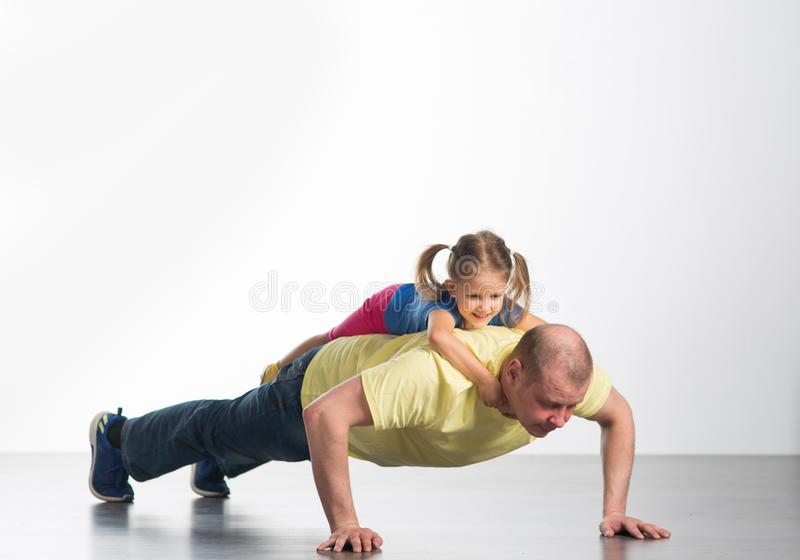 Young man playing with baby royalty free stock photo