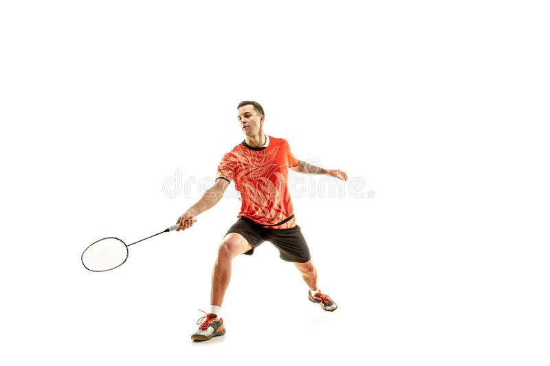 Young male badminton player over white background. Young man playing badminton over white studio background. Fit male athlete isolated on white. badminton player stock images