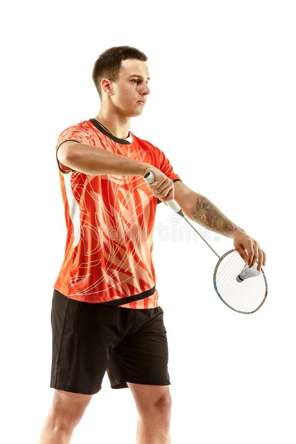 Young male badminton player over white background. Young man playing badminton over white studio background. Fit male athlete isolated on white. badminton player stock image