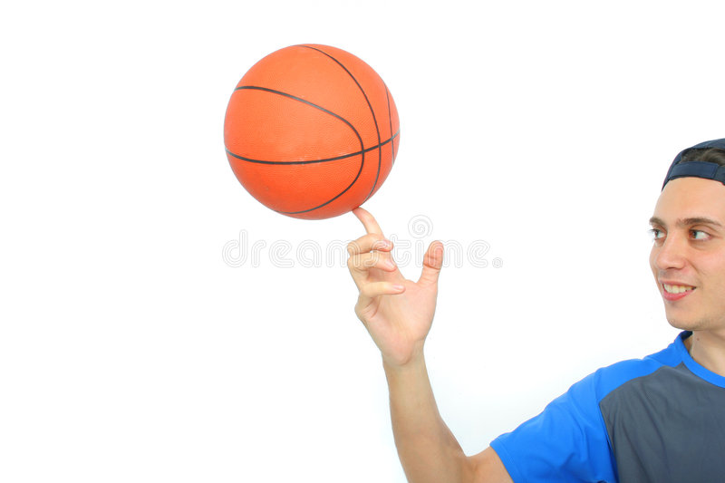 Young man playing basketball isolated. Funny expression From my sport series royalty free stock image