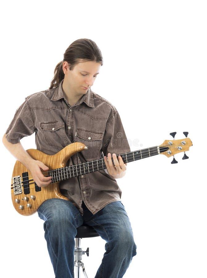 Young man is playing a bass guitar stock photos