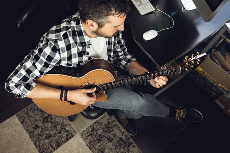 Young man playing classical guitar in studio. Musician guitarist. Young man playing classical guitar in studio.Concept of musician guitarist stock photos