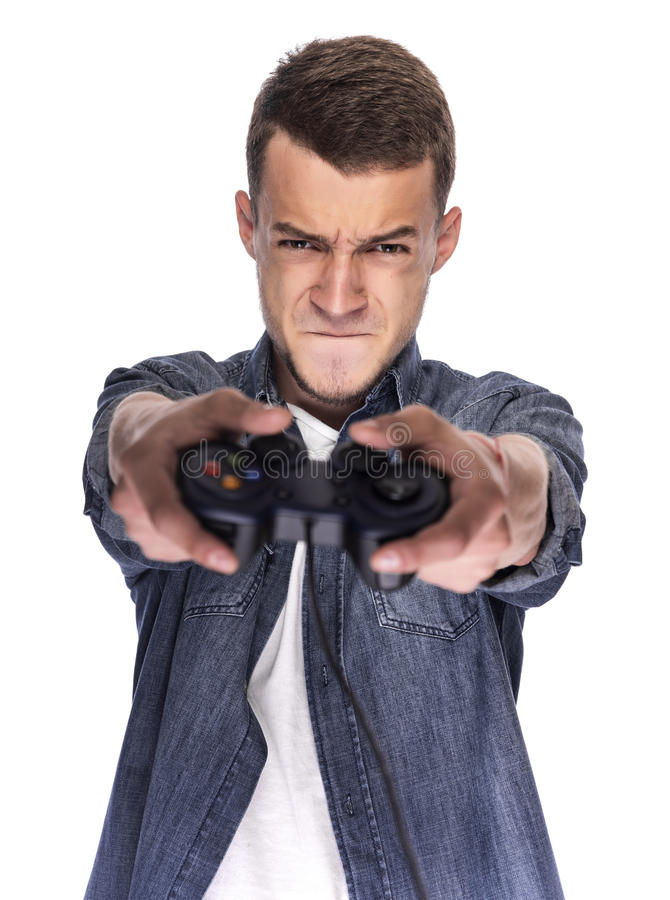 Young man playing on console or computer. stock photography