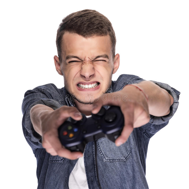 Young man playing on console or computer. royalty free stock photo