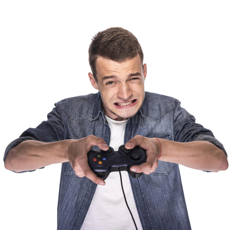 Young man playing on console or computer. royalty free stock image