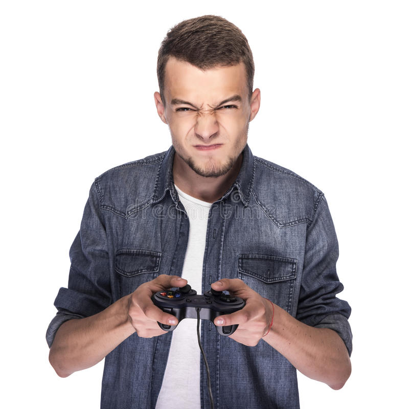 Young man playing on console or computer. stock photo