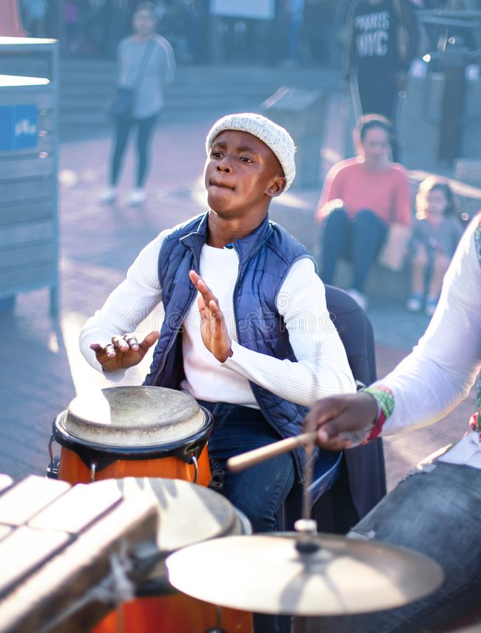 Young man playing the Djembe drum stock images