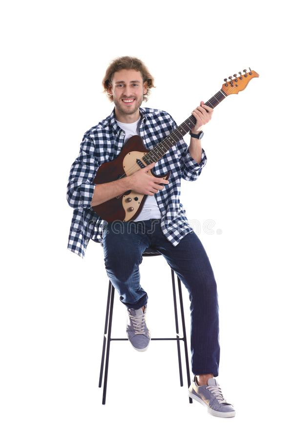 Young man playing electric guitar on white royalty free stock photography