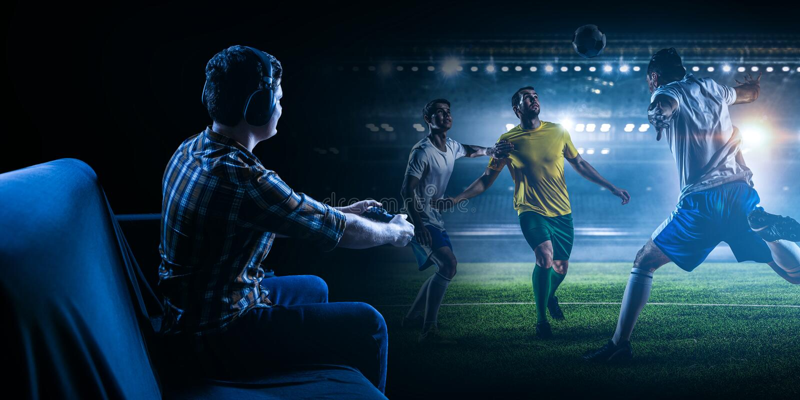 Young man playing football video game royalty free stock photo