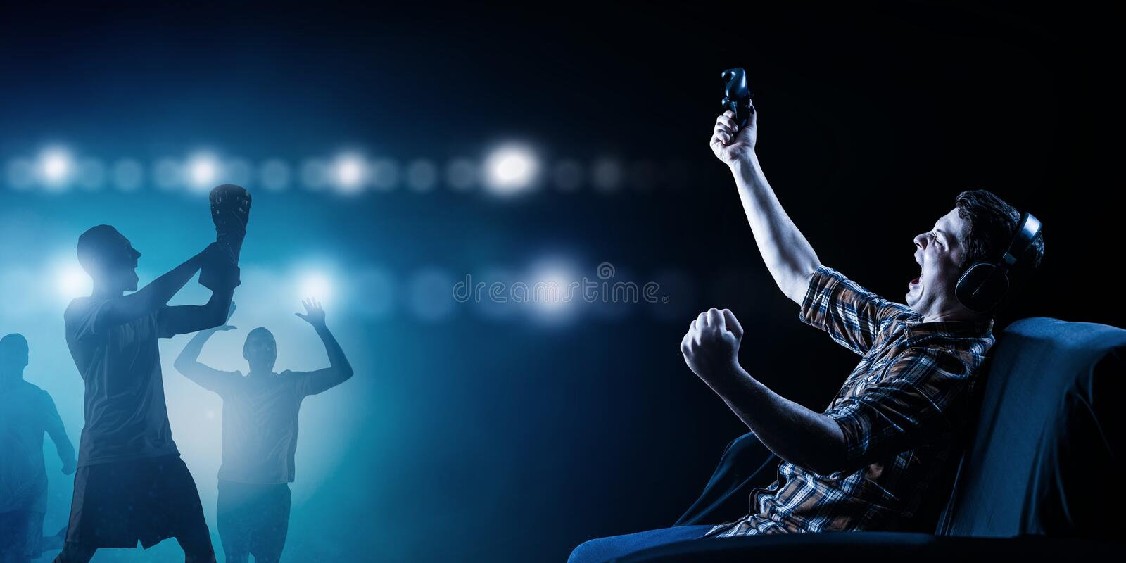 Young man playing football video game stock image