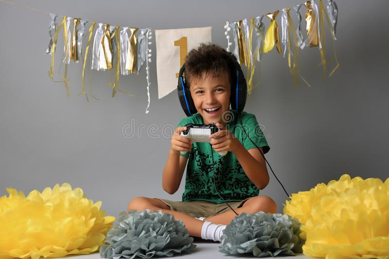 Cute boy playing video games royalty free stock images