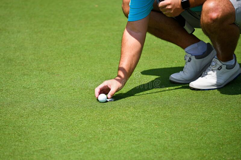 Young Man Playing Golf is Placing Gol Ball stock images