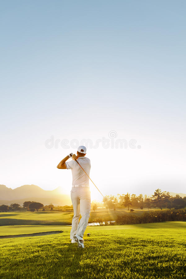 Young man playing golf on a sunny day stock images